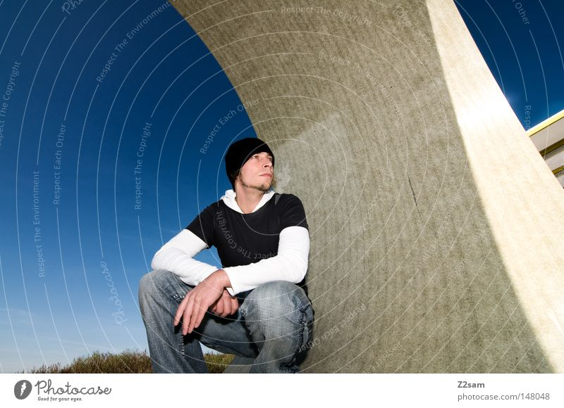 curve Stand Human being Man Cap Style Round Concrete Construction site Sky Easygoing Wide angle Motionless Material Think Architecture Center point Jeans Blue