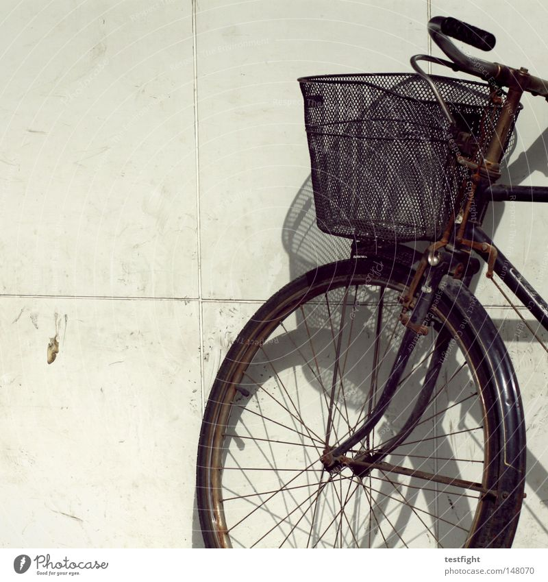 turned off Bicycle In transit Wall (building) Basket Light Transport Lean Parking bicycle basket Shadow