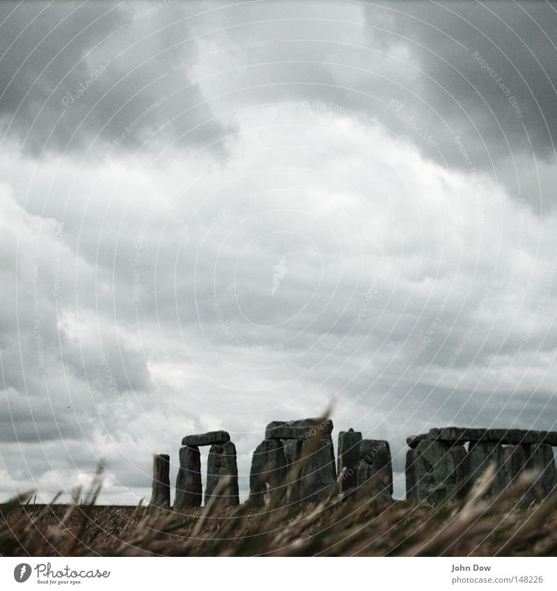 Stonehenge I Colour photo Exterior shot Deserted Copy Space top Art Culture Nature Sky Clouds Storm clouds Wind Gale Thunder and lightning Grass Landmark
