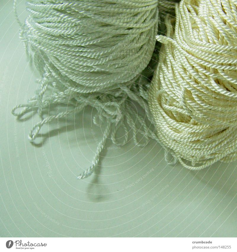 Cordy and twisted Decoration Craft (trade) Sewing thread Plaited Rotated Knot Muddled Product photography Loop Colour photo Close-up Detail Handcrafts Wool