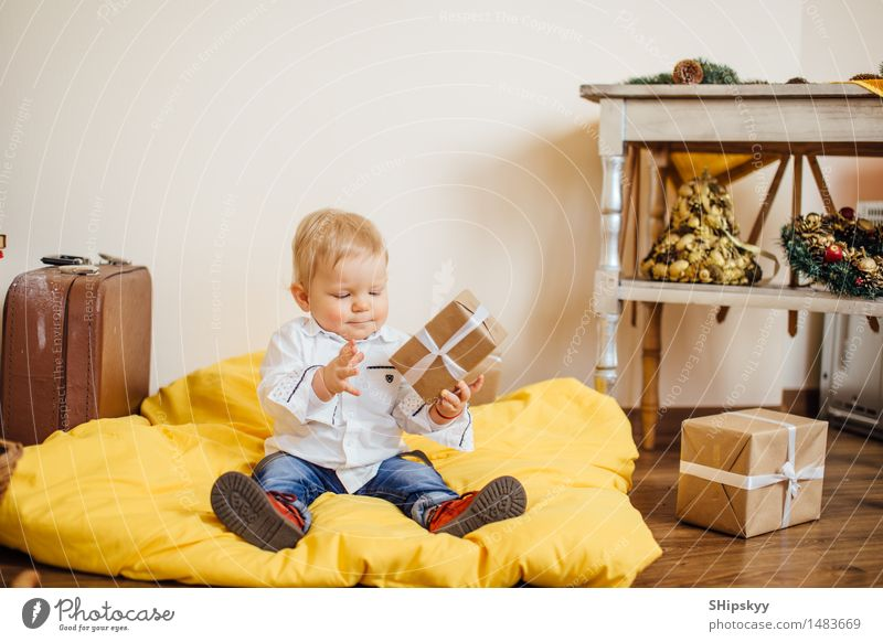 Little boy sitting on the bed and smile Human being Child Christmas & Advent Blue Green Beautiful White Hand Red Black Yellow Life Boy (child) Laughter Small