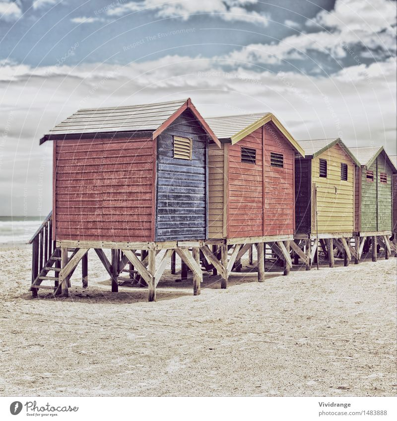 Row of painted colored beach huts Sky Nature Vacation & Travel Blue Colour Summer Water White Ocean Red Landscape Clouds Winter Beach Yellow Architecture