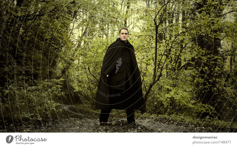 Frodo on his way to Rivendell. Lord of the Rings Forest Black Coat Man Green Brown Tree Footpath Lanes & trails Solidify Amazed Expectation Testing & Control