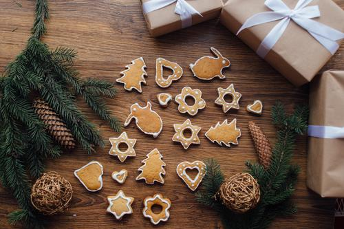 Cookies lying on the table with gifts and winter tree Christmas & Advent Winter Eating Food Birthday Creativity Ice cream Sweet Paper Easter Peace Serene Candy