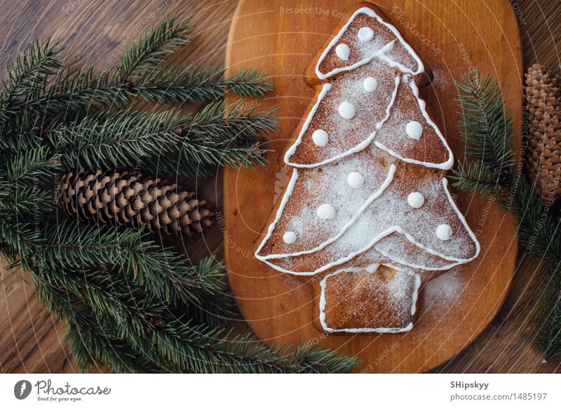 Yellow cookies lying on the table with Christmas tree and gifts Christmas & Advent Green White Tree Black Eating Food Brown Orange Gold Birthday Cake Dessert