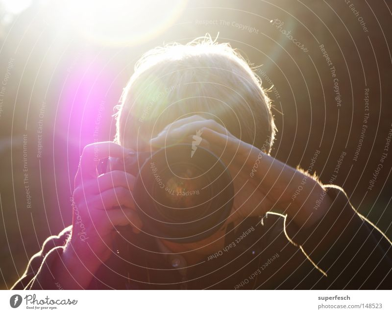 Man Camera Photographer Take a photo Shoot Objective Lens flare Focus on