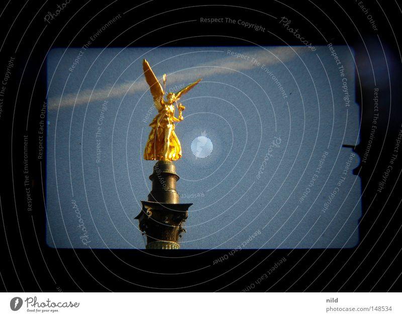 Isarstadt (analogue-digital) Sky Sky blue Vapor trail Symmetry Viewfinder Statue Bavaria Landmark Monument Angel anlog Digital photography cinematically