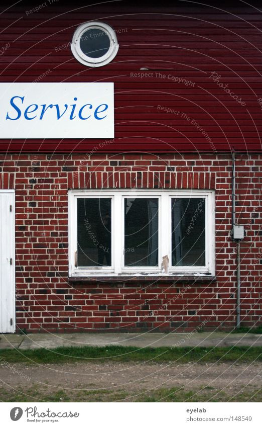 Here service is still written in capital letters House (Residential Structure) Building Window Round Rose window Stone Facade Wood Expressway exit Typography