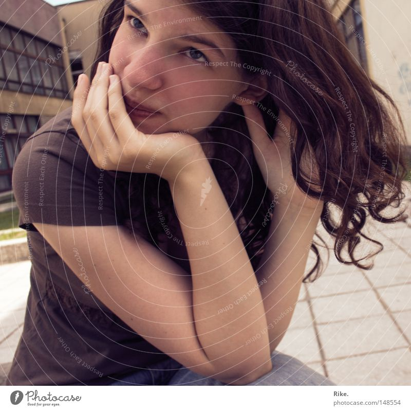 Dreaming. Brown Hair and hairstyles Youth (Young adults) Woman Portrait photograph Curl Beautiful Think Close-up T-shirt Grief Feminine Doubt Skeptical Distress