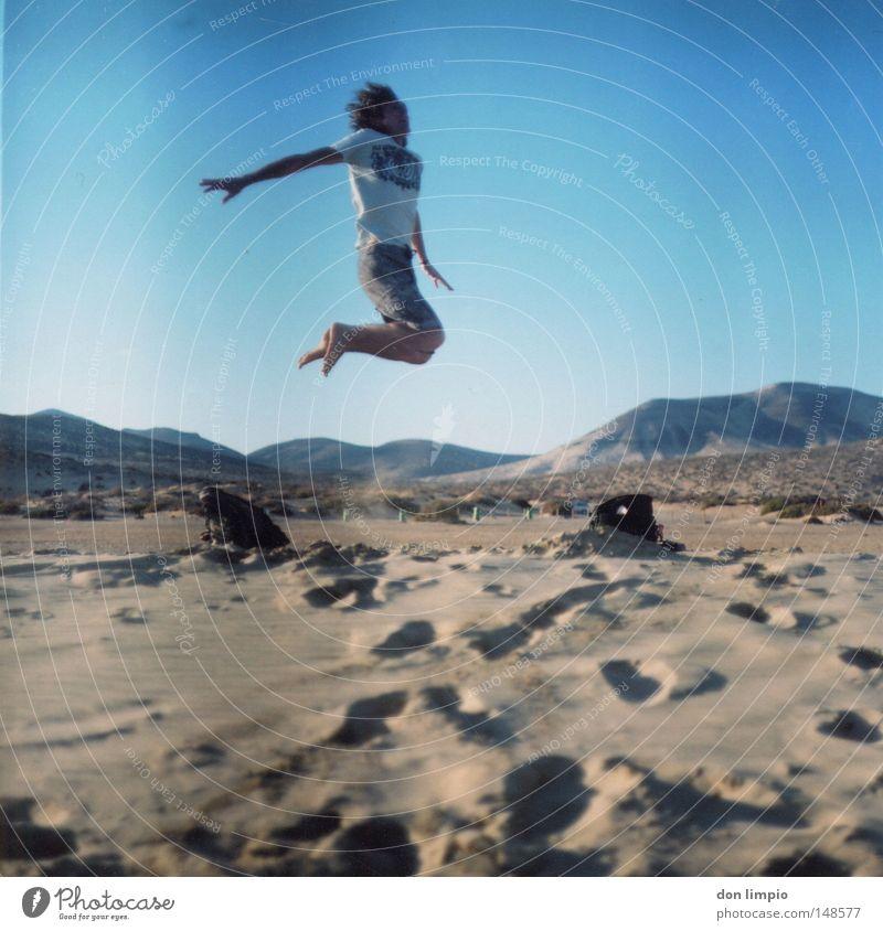 stay high Human being Jump Beach Sand Desert Horizon Blue Footprint Joy Tall Sky Middle Bag Fuerteventura Landscape format Roll film Mountain sotavento