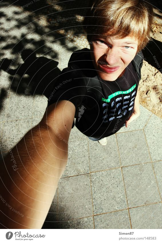 bizarre Above Lanes & trails Human being Perspective Wide angle T-shirt Arm Light Shadow Sidewalk Funny Facial expression Bird's-eye view Beautiful weather