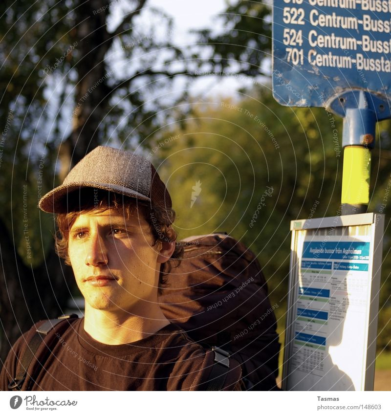 a sunny boy, a sunny day Contentment Summer Man Adults Youth (Young adults) Bus Hat Wait Bus terminal Station Sweden Backpack Backpacking Tourist Interrail