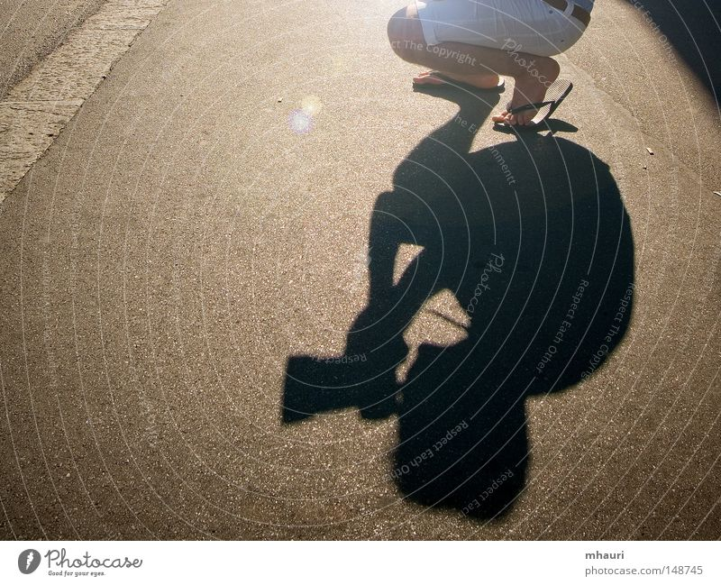 shadow Photographer Shadow Sun Light Silhouette Conceptual design Sandal Man Camera Objective Legs Kneel Tunnel Leisure and hobbies Street