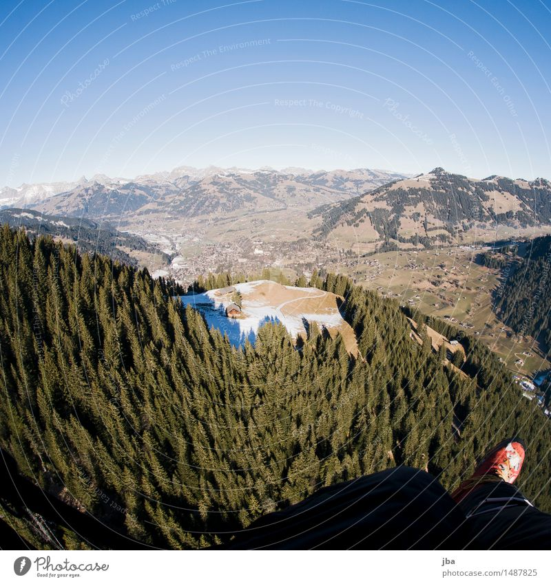701 Flight to Gstaad Relaxation Calm Leisure and hobbies Trip Far-off places Freedom Mountain Sports Paragliding Feet Landscape Air Sky Winter Climate change
