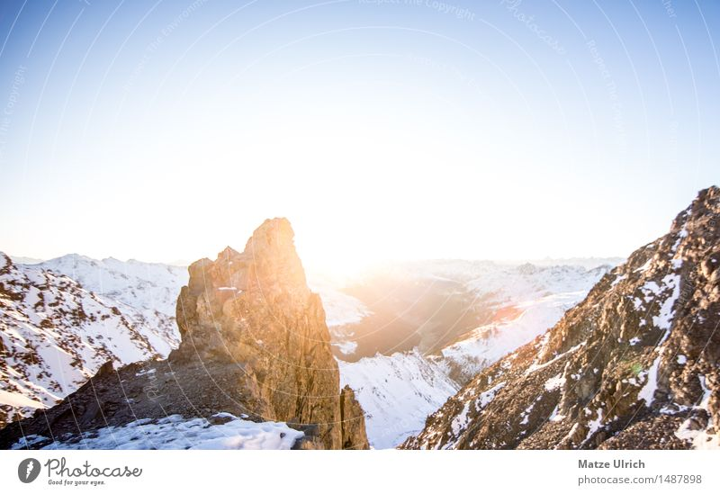 Rock in sunlight Sky Cloudless sky Horizon Sun Sunrise Sunset Sunlight Winter Snow Hill Alps Mountain Peak Snowcapped peak Glacier Far-off places Colour photo