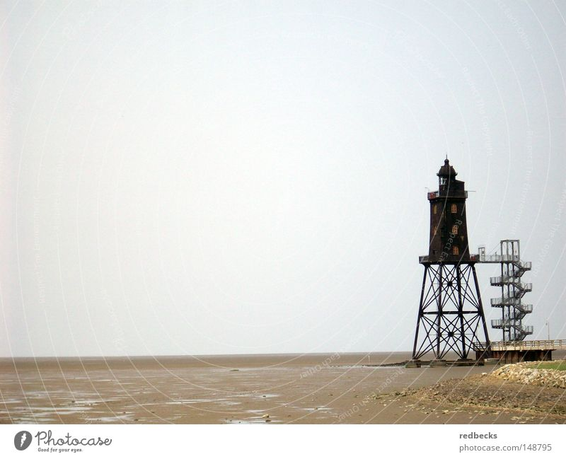 Lighthouse at low tide Architecture Low tide Mud flats Beach Water Ocean North Sea Germany Europe Beacon Lamp Coast Building Steel processing Lighting Conduct