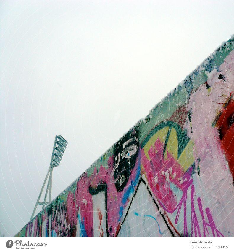 giraffe behind the wall Berlin Floodlight Stadium Downtown Berlin Prenzlauer Berg Graffiti Multicoloured Across Wall (building) Border wall park Giraffe