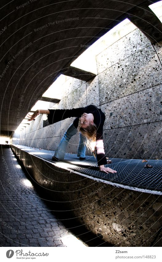 stretch Tunnel Concrete Passage London Underground Subsoil Light Shadow Dark Bright Radiation Woman Feminine Blonde Articulated Style Fisheye Grating Stone