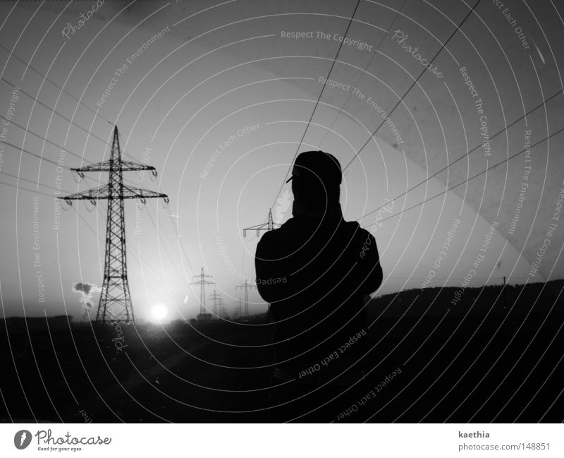 unknown sun worshipper Sun Man Adults Line Dark Energy Electricity pylon Contrast Sky Environment Technology Energy industry Silhouette Black & white photo
