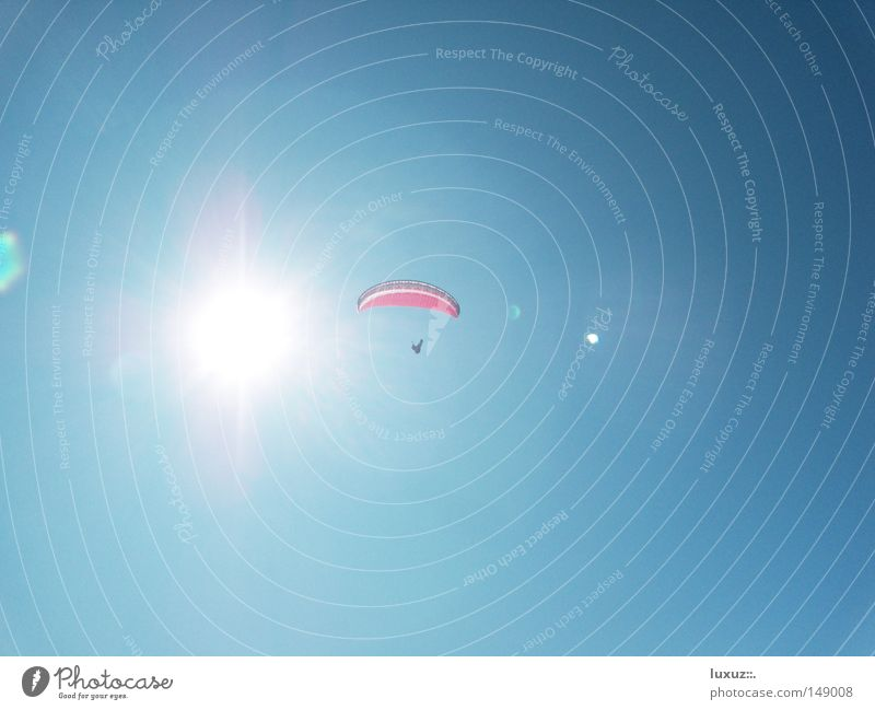 Play with fire Paragliding Parachute Sun Hot Tall Sports Dangerous Playing Sky Paraglider (parachute) Aircraft things to fly Flying Blue Threat UV
