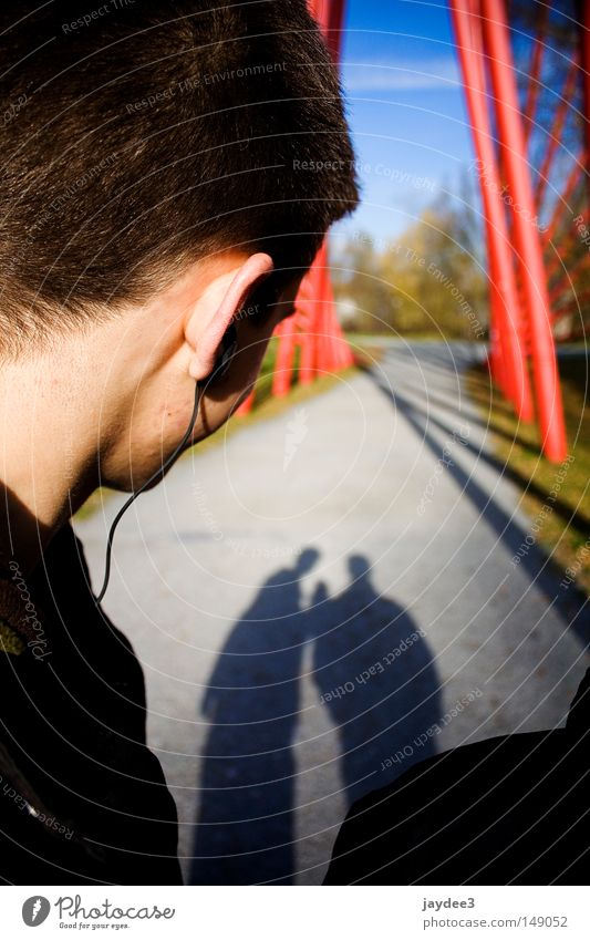 Youth (Young adults) Beautiful Music Lanes & trails 2 Together Ear To go for a walk Beautiful weather Headphones Depth of field Shadow play