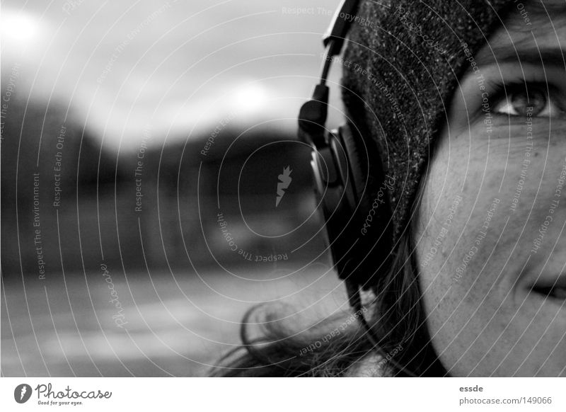 audio enjoyment Black & white photo Exterior shot Copy Space left Deep depth of field Central perspective Upward Joy Happy Relaxation Music Woman Adults