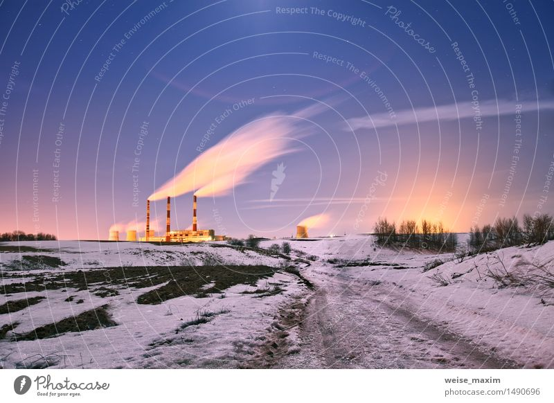 Power plant in the night. Sky Nature City Plant Blue White Landscape Clouds Winter Yellow Snow Building Lamp Pink Ice Vantage point