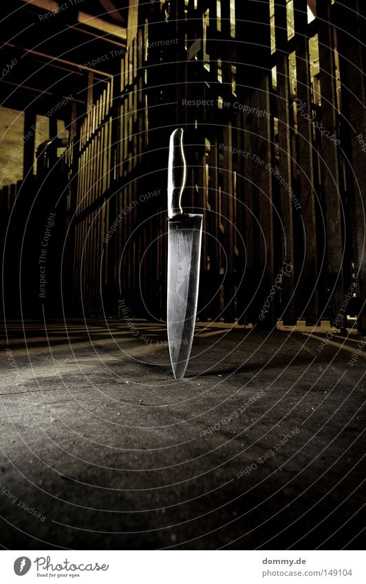 smooth Corner Door handle Cut Attic Grating Dark Reflection Shaft of light Shadow Anger Aggravation Knives knife Metal cutting edge Floor covering Dirty Lamp
