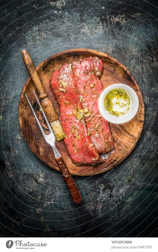 Marinated lamb fillet for cooking or grilling Food Meat Herbs and spices Cooking oil Nutrition Dinner Banquet Plate Fork Table Kitchen Barbecue (apparatus)