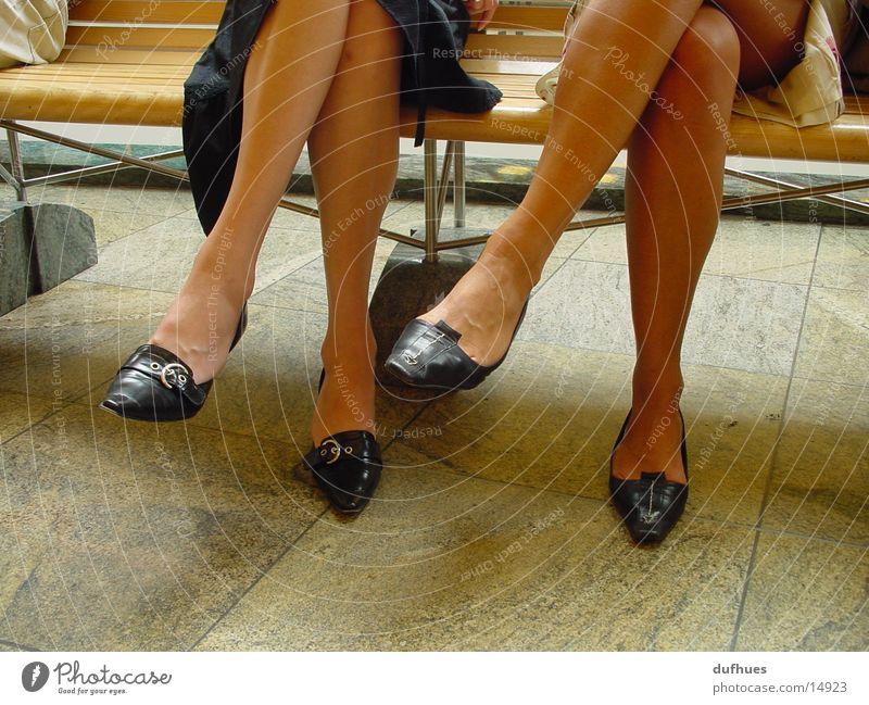 Two pairs of feet Footwear Woman Feet Legs Sit