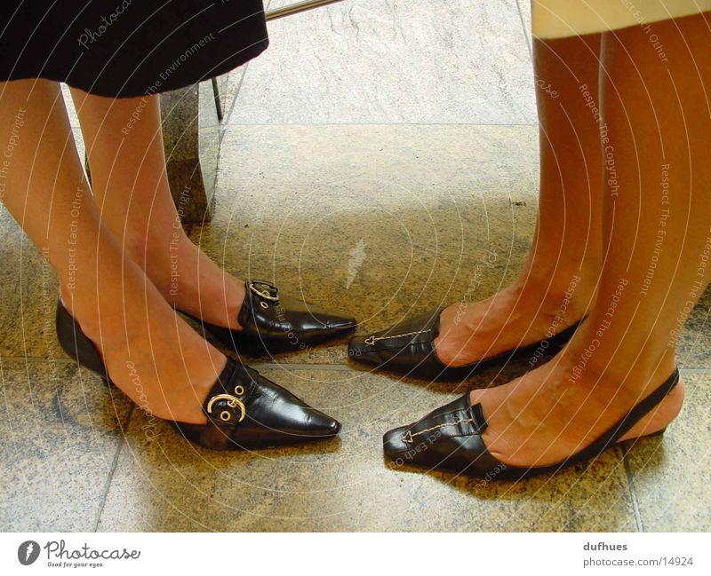 Two pairs of feet Footwear Legs Feet Facing Stand