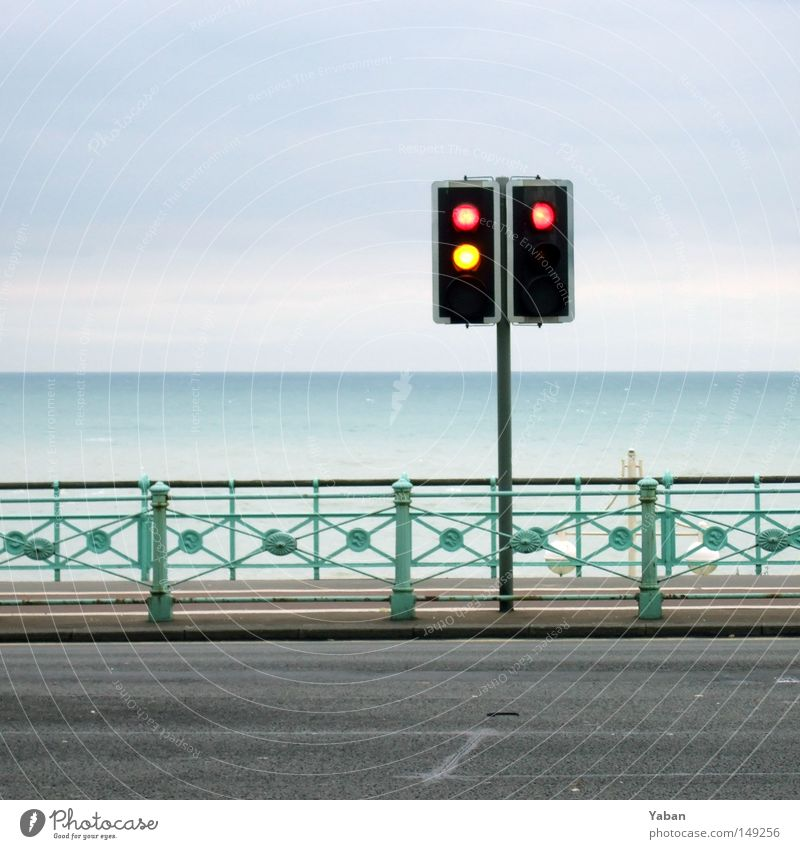 Redlight Beach Traffic light Yellow Stop Promenade Ocean Horizon Calm Peace Greeny-blue Blue-green Brighton England Traffic infrastructure Street sign