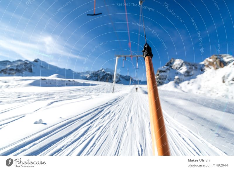 ski lift Lifestyle Leisure and hobbies Ski lift anchor lift Sports Winter sports Skis Snowboard Ski run elevator track Environment Nature Sky Sun Sunlight