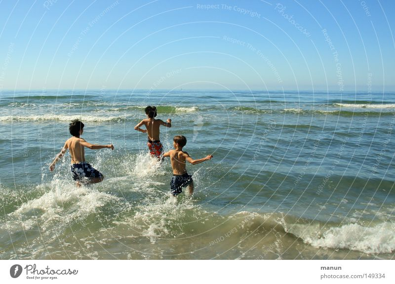 Human being Child Youth (Young adults) Blue Vacation & Travel Summer Ocean Joy Relaxation Life Boy (child) Movement Jump Happy Family & Relations Friendship