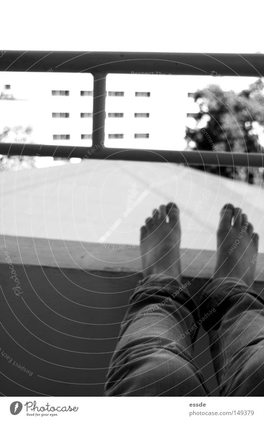 balcony views Black & white photo Contentment Relaxation Legs Feet Wall (barrier) Wall (building) Balcony Dangerous Perspective Put one's feet up Handrail