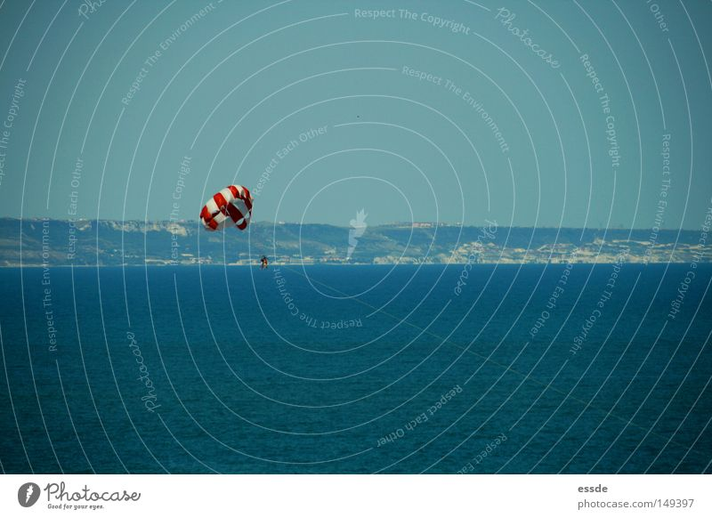 Human being White Ocean Blue Red Joy Vacation & Travel Colour Sports Playing Tall Vantage point Paragliding Striped Height Parachute