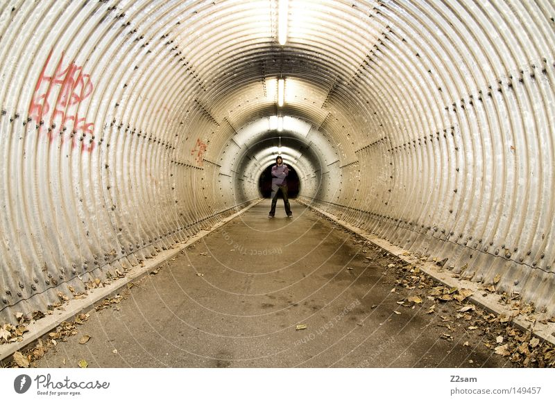 Human being Man Winter Leaf Loneliness Dark Autumn Style Architecture Concrete Perspective Round Stand Characters London Tunnel
