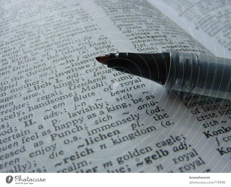 Pen in book Book Encyclopedia lookup