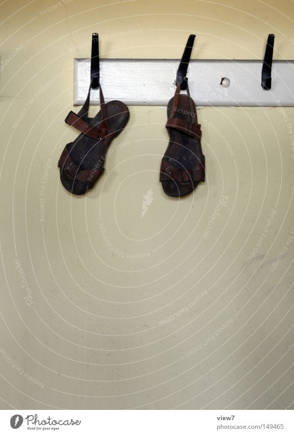 sandals Sandal Footwear Walking Occur Hang up Hanger Clothing Hallstand Hallway Detail Leather strip Buckle Shoe sole Feet Wall (building) Wallpaper Plaster