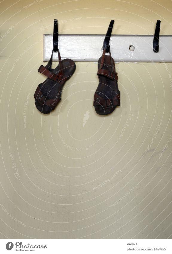 sandals Sandal Footwear Walking Occur Hang up Hanger Clothing Hallstand Hallway Detail Leather strip Buckle Shoe sole Feet Wall (building) Wallpaper Plaster