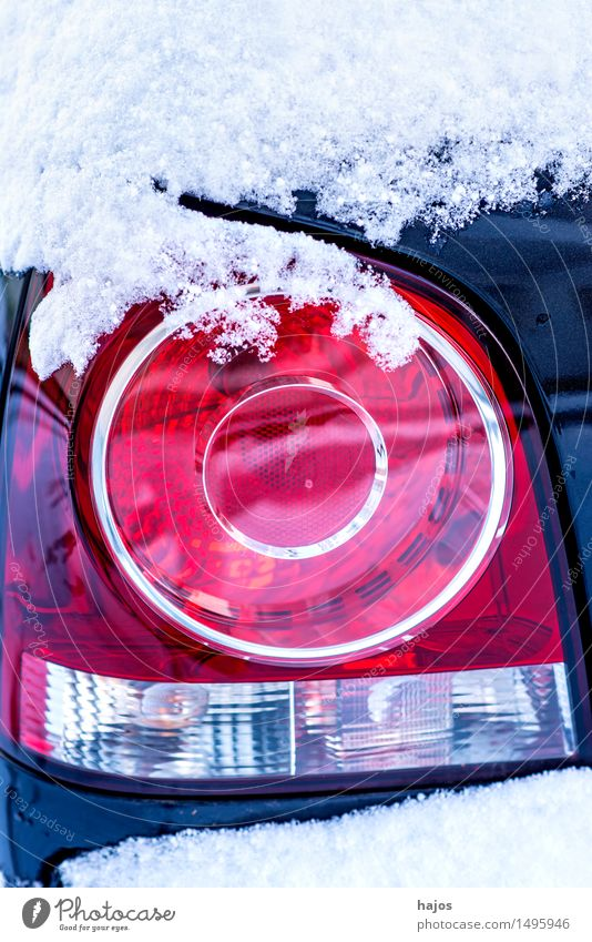 Snow on the rear light of a car Calm Winter Weather Transport Car Blue Red White Idyll Alpina snowcap Rear light Brake light road conditions High pressure
