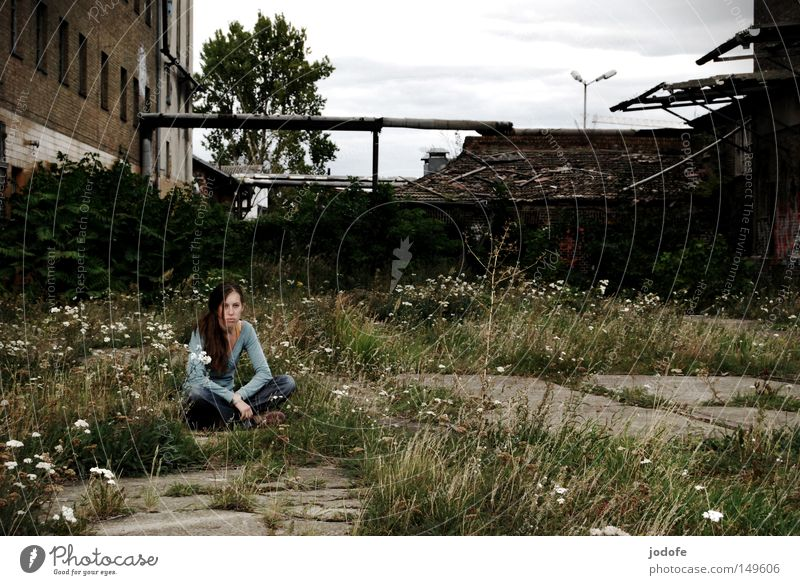 Woman Human being Plant Loneliness Autumn Feminine Grass Gray Building Concrete Sit Grief Gloomy Ground Floor covering