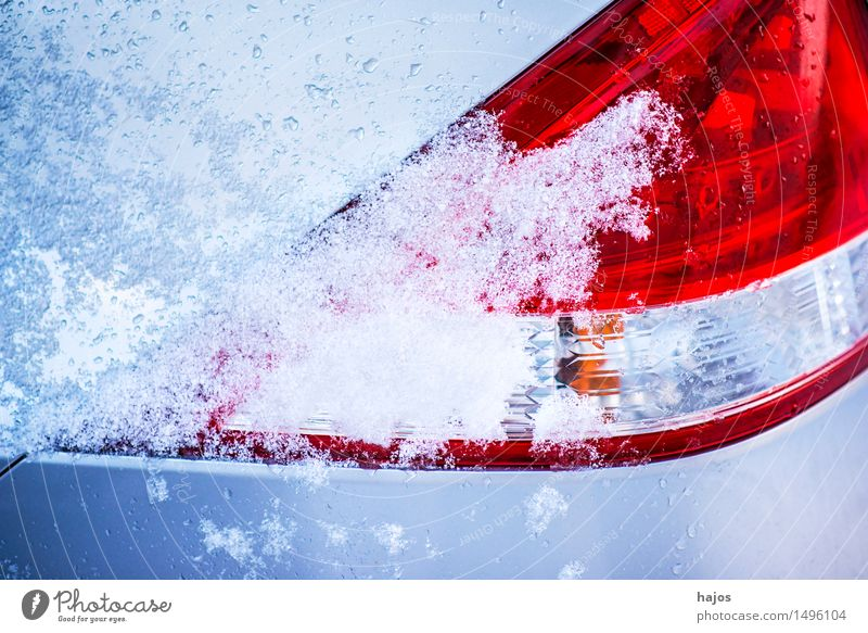 Snow on the rear light of a car Calm Winter Weather Ice Frost Transport Car Blue Red White Idyll Alpina snowcap Rear light Brake light road conditions Stlileben