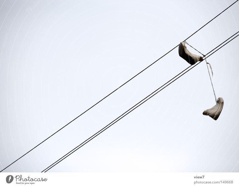 on the fly Footwear Boots Transmission lines Shoelace Throw Get stuck Adversity High voltage power line Cable Aggravation Stupid Disastrous Provocative Brash