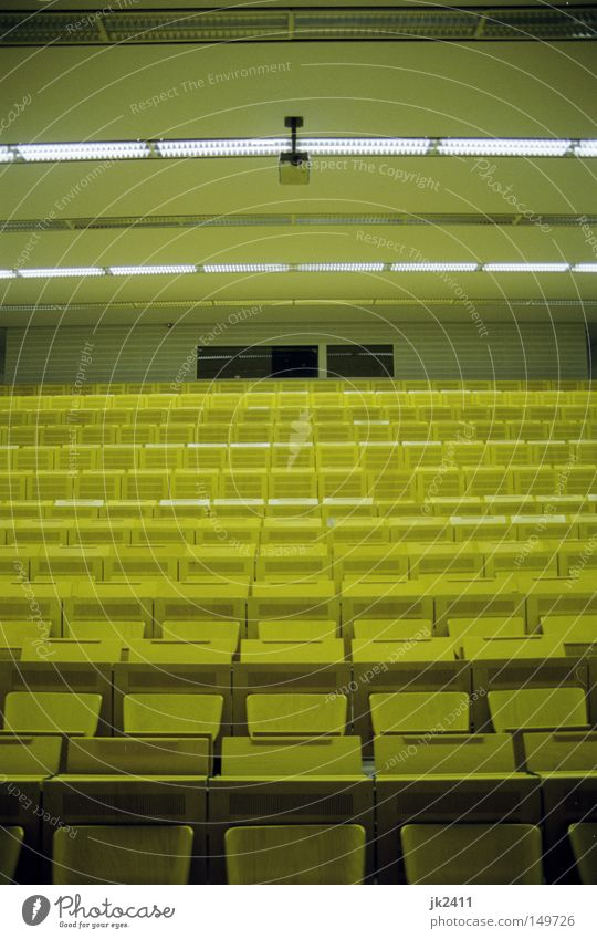 comfortable studying 1 Education Academic studies Lecture hall Yellow Symmetry Seating Data projector Derelict tuition fees Retro Empty Loneliness