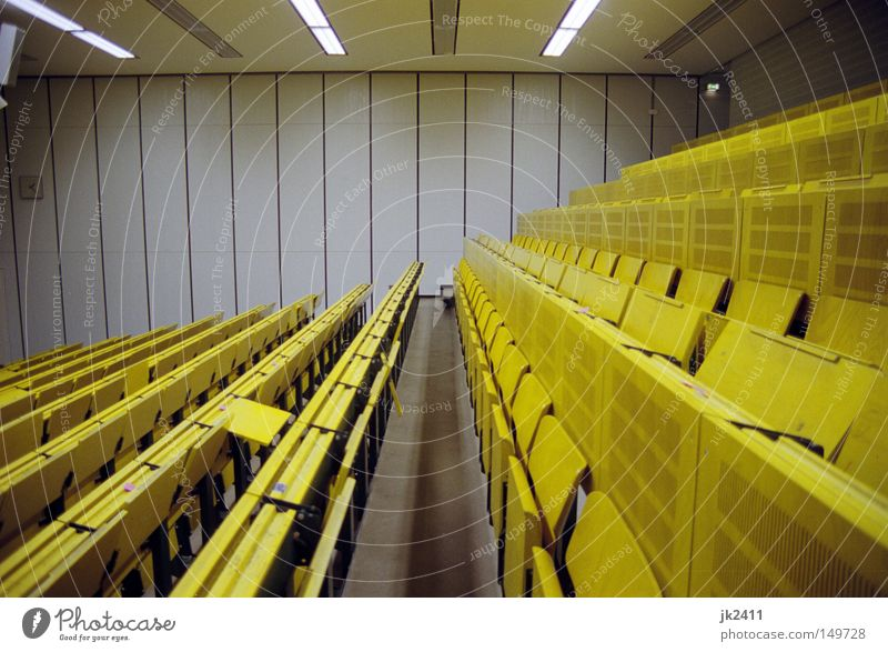 comfortable studying 2 Education Academic studies Lecture hall Yellow Symmetry Seating Data projector Derelict Retro tuition fees Empty Loneliness