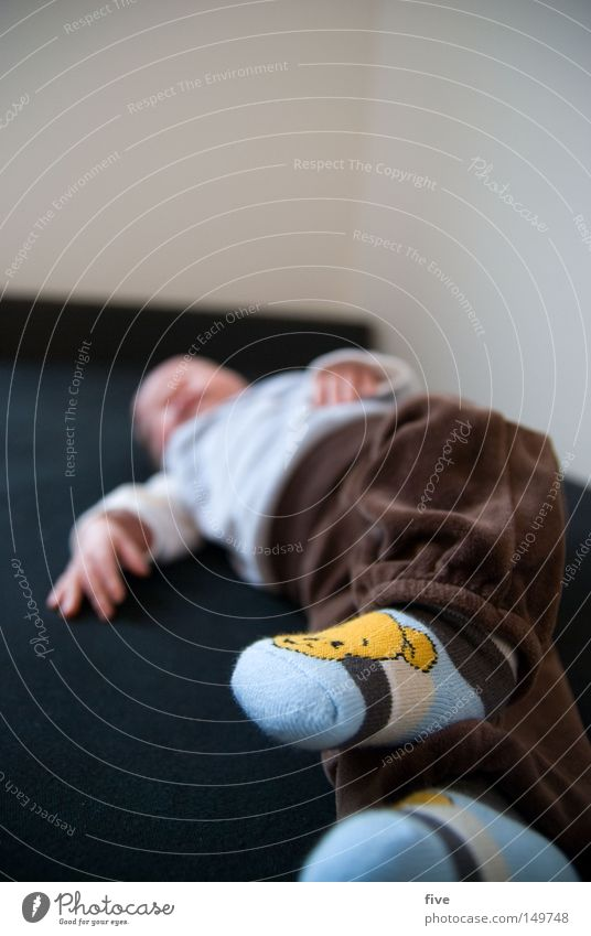 Human being Child Hand White Calm Face Relaxation Gray Happy Small Legs Feet Brown Contentment Baby Flat (apartment)