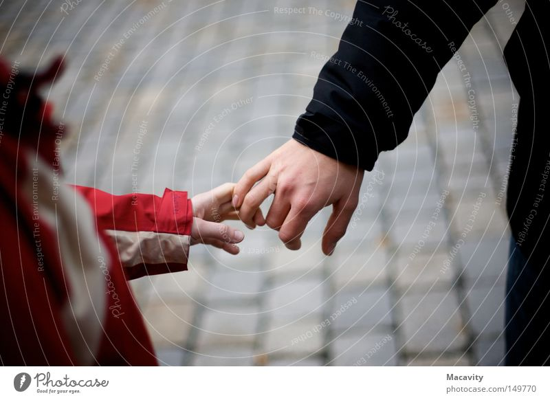 Do not let go Trust Friendship Child Man Woman Relationship Hand Fingers Grasp Cobblestones Anorak Release Touch Connection Red Gray Small Jacket Cold Winter