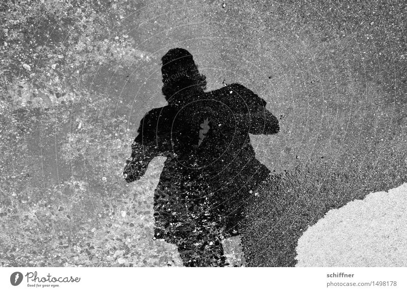 Who's afraid of the black man? Human being Masculine Young man Youth (Young adults) 1 Gray Black White Puddle Reflection Mirror image Dark Fear Harrowing Cruel