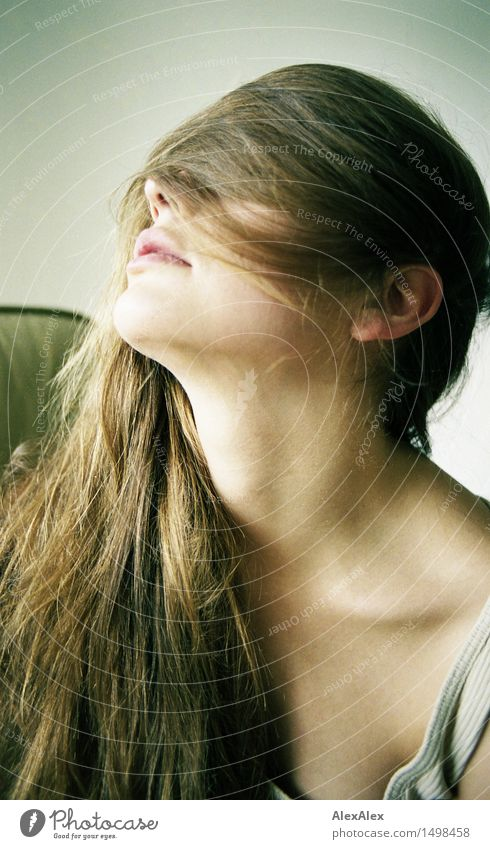 clear view - young woman has her long brunette hair laid sideways over her face and looks through it Lifestyle Style pretty Hair and hairstyles Well-being